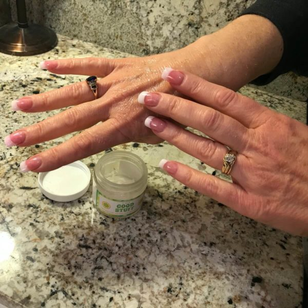 the good stuff cbd cream being applied on hands